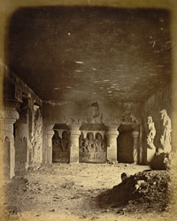 Interior of the Ramesvara rock-cut temple, looking towards sculpture at the far end